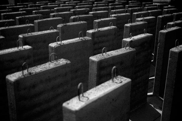 In Yeruham, 9 foot-high concrete blocks sit at a concrete factory in March. The blocks will be used in the construction of Israel's In In Yeruham, 9 foot-high concrete blocks sit at a concrete factory in March. The blocks will be used in the construction of Israel's separation barrier. Photo by Oded Balilty/AP/FILE